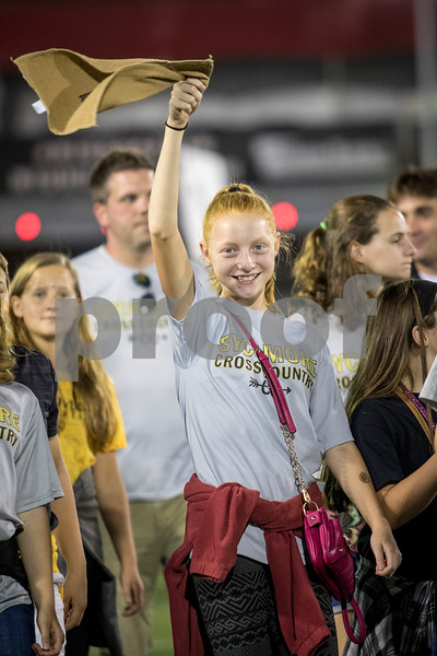 Sam Buckner for Shaw Media.<br /> Kyley VonSchnashe, 13, waves a gold towel in the parade of athletes on Friday September 15, 2017.