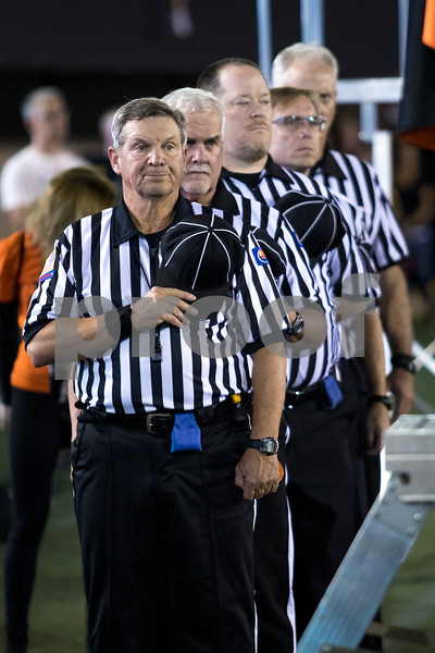 Sam Buckner for Shaw Media.<br /> Officials for the game stand for the National Anthem on Friday September 15, 2017.
