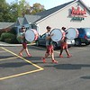 Drumline members parade through the parking lot at the Redhawk Grille.<br />  (Jean Bonchak for The News-Herald)