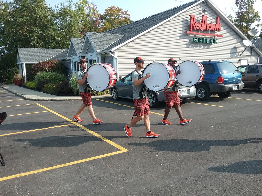 . Drumline members parade through the parking lot at the Redhawk Grille.  (Jean Bonchak for The News-Herald)
