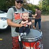 Drummer Jonathan Monacelli, a graduate of Mentor High School and  current resident of North Royalton, poses with young Browns fan Milo McDaniel of Mentor. (Jean Bonchak for The News-Herald)
