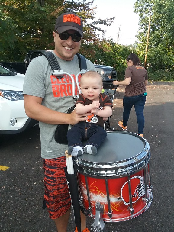 . Drummer Jonathan Monacelli, a graduate of Mentor High School and  current resident of North Royalton, poses with young Browns fan Milo McDaniel of Mentor. (Jean Bonchak for The News-Herald)