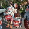 Tim Purchase (a.k.a. Pit Dawg) of Painesville, gives directions to the official Cleveland Browns Drumline prior to the Brownsbackers Dawgs of Courage tailgate event on Sept. 17 at the Redhawk Grille in Concord Township. (Jean Bonchak for The News-Herald)