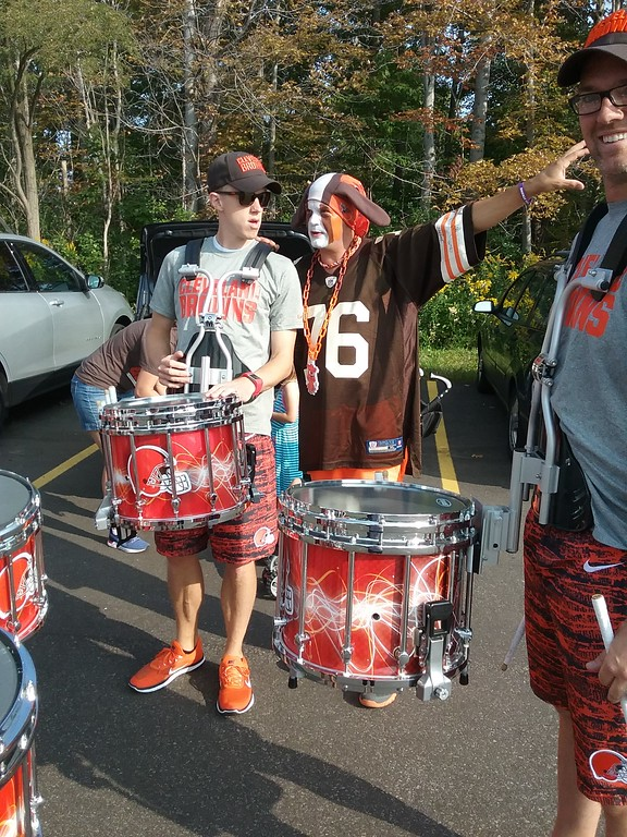 . Tim Purchase (a.k.a. Pit Dawg) of Painesville, gives directions to the official Cleveland Browns Drumline prior to the Brownsbackers Dawgs of Courage tailgate event on Sept. 17 at the Redhawk Grille in Concord Township. (Jean Bonchak for The News-Herald)