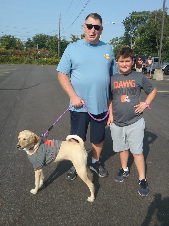 . Anthony Zappitelli and his son Nathan, brought along their Browns spirited pup Willy, to join in the tailgating fun. The Zappitellis live in Concord Township. (Jean Bonchak for The News-Herald)