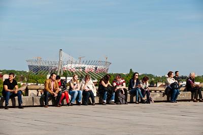 Pedestrians and National Stadium in background, Warsaw, Poland