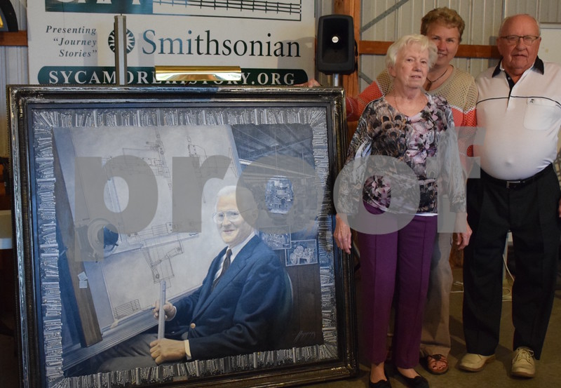"""A portrait of Hollis R. """"Pete"""" Hilstrom, the owner of Driv-Lok, was donated to the Sycamore History Museum during a dedication on Monday, Sept. 18. From left, Hilstrom's daughter Karen Duffey, granddaughter Kim and son-in-law Bud."""