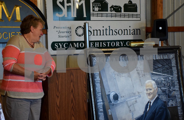 "Kim Duffey, the granddaughter of Hollis R. ""Pete"" Hilstrom, discusses Driv-Lok and her grandfather's legacy during the dedication of his portrait Monday to the Sycamore History Museum."