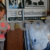 """Kim Duffey, the granddaughter of Hollis R. """"Pete"""" Hilstrom, discusses Driv-Lok and her grandfather's legacy during the dedication of his portrait Monday to the Sycamore History Museum."""