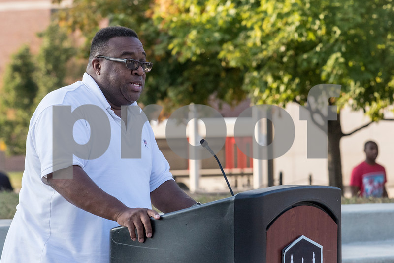 Sam Buckner for Shaw Media.<br /> Bill McCoy Introduces the speakers before the Unity March on Tuesday September 19, 2017 at the MLK Commons.