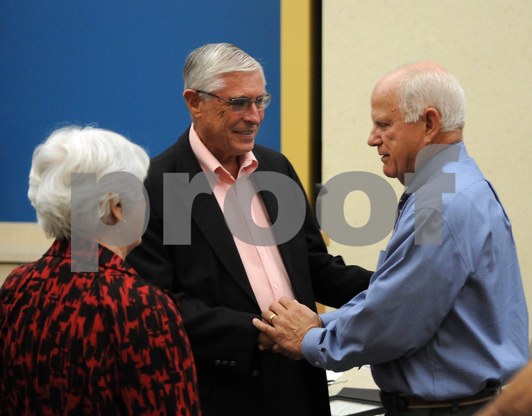 Sycamore Mayor Curt Lang, right, congratulates Bob Pritchard during an open house honoring the former state representative on Wednesday evening.<br /> Steve Bittinger - For Shaw Media