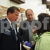 Candidates Jim Walz and George Weber listen to a resident after the Sept. 18 forum.