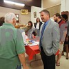 Candidate Victor Swanson speaks with residents after a candidate forum at the UAW hall in Montgomery.