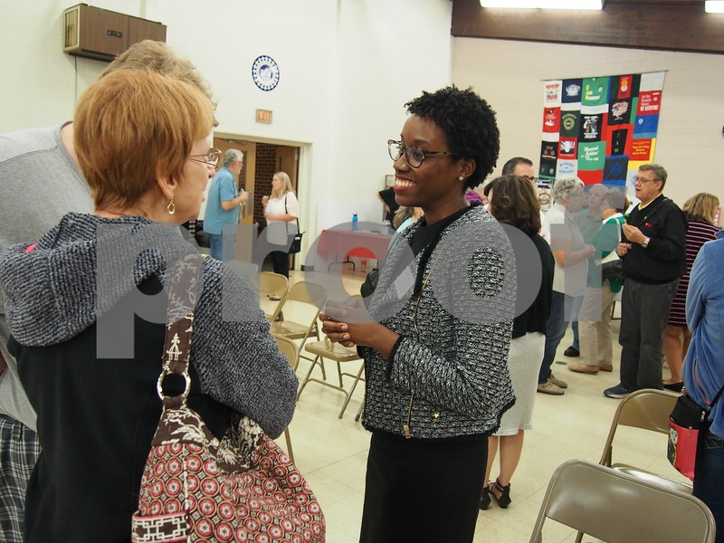 Candidate Lauren Underwood speaks with residents following the Sept. 18 forum.