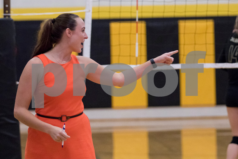 Sam Buckner for Shaw Media.<br /> Dekalb head coach Jamie DiMaggio  cheers on her team on Wednesday September 20, 2017 at Sycamore High School.