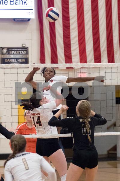 Sam Buckner for Shaw Media.<br /> Jasmine Kemp goes to spike the ball on Wednesday September 20, 2017 at Sycamore High School.