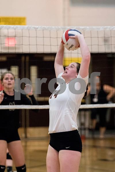 Sam Buckner for Shaw Media.<br /> Emma Fellabaum sets the ball on Wednesday September 20, 2017 at Sycamore High School.