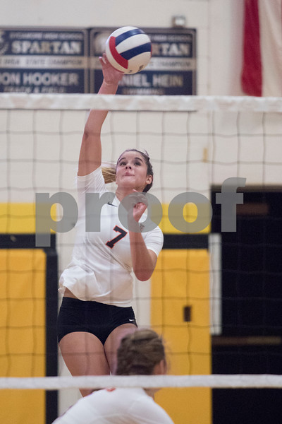 Sam Buckner for Shaw Media.<br /> Hannah Oehlberg spikes the ball on Wednesday September 20, 2017 at Sycamore High School.