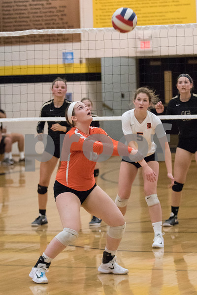 Sam Buckner for Shaw Media.<br /> Lydia Sabanish bumps the ball on Wednesday September 20, 2017 at Sycamore High School.