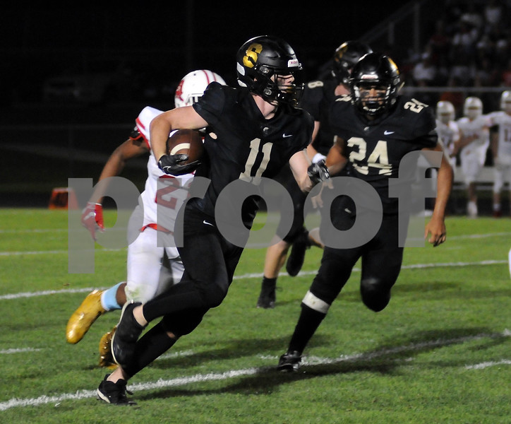 Spartan Kyle Antos carries the ball during first half action in Sycamore on Friday.<br /> Steve Bittinger - For Shaw Media
