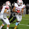 Ottawa running back Cedric Fairrow takes a handoff from Brett Galleti in first half action at Sycamore on Friday.  Steve Bittinger - For Shaw Media