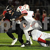 Ottawa linebacker Damonte Coleman tries to slow down Spartan Gavin Crofoot during first half action on Friday in Sycamore.  Steve Bittinger - For Shaw Media
