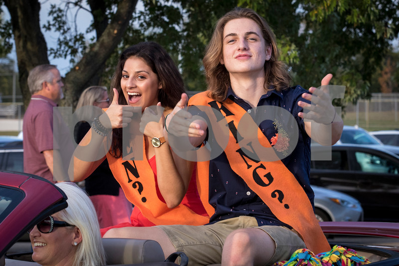 Sam Buckner for Shaw Media.<br /> Homecoming court canidates Miranda Garcia and Jim Sauter pose in the back of a convertible during the parade on Thursday September 21, 2017.