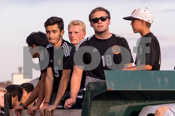 Sam Buckner for Shaw Media.<br /> Varsity soccer players look out over the back of a truck during the parade on Thursday September 21, 2017.