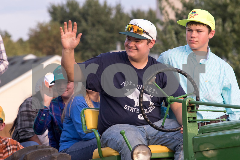 Sam Buckner for Shaw Media.<br /> Trevor Yaeger waves to spectators while pulling the FFA float by a tractor on Thursday September 21, 2017.