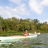"""Jonathan Tressler — The News-Herald <br> On Bass Lake in Munson Township Sept. 1, Cleveland Amateur Boatbuilding and Boating Society member Joe Lose, front, paddles the 14' 7"""" wooden Fox boat he built between October and December, 2016 as CABBS President Ed Neal follows in the Six-Hour Canoe members of the group built as a prototype for the 2018 Progressive Mid-America Boat Show in Cleveland."""