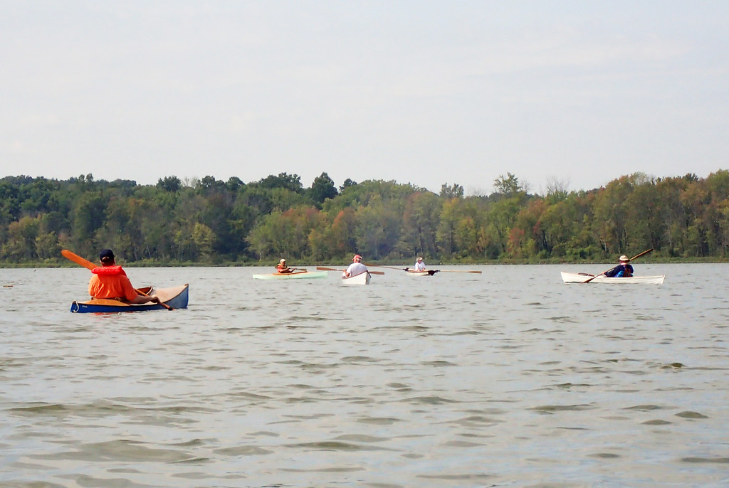 . Jonathan Tressler � The News-Herald <br> Members of the Cleveland Amateur Boatbuilding and Boating Society paddle handmade, wooden vessels around the Geauga Park District�s Bass Lake in Munson Township during the group�s messabout gathering Sept. 1.