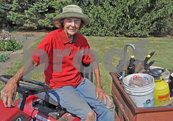 Barry Schrader for Shaw Media<br /> Jeanne Pritchard is shown astride her riding mower, ready to tackle acres of lawn that take her some nine hours to finish each time.