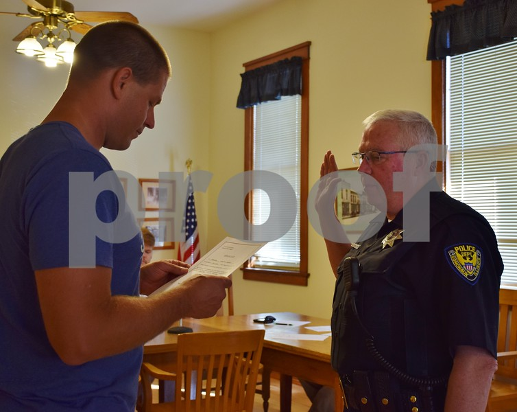 Bill King is sworn in Wednesday as Somonauk's interim police chief during the Somonauk Village Board meeting. Current Police Chief Richard Smith will retire at the end of the month, and King will run the department until December, when a new chief will be appointed. Smith has been a patrolman for the Somonauk Police Department for three years and was the interim police chief in Sandwich from 2010 to 2013.