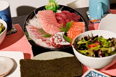 Selection of fresh raw fish, sashimi, served on table
