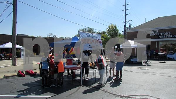 Folks gather around Betty Jean's Soul Food stand during Trucktober Fest on Sunday at Faranda's in DeKalb.