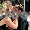 Renee Burger, a Youth Services Bureau volunteer, paints the face of Kyra Jencks, 17, of DeKalb, on Sunday during Trucktober Fest at Faranda's in DeKalb.