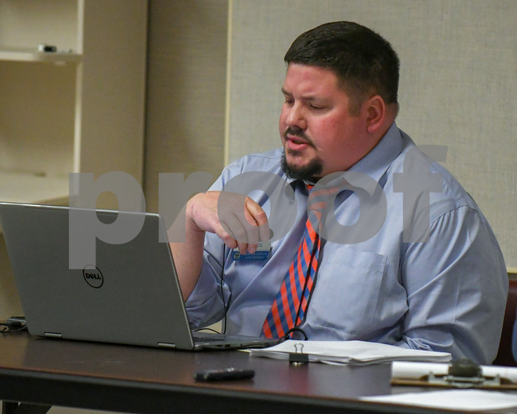 Community coordinator Derik Hiland reads new business items September 26 during the DeKalb County Planning and Zoning Committee meeting about special use permits for solar farms.