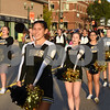 Sycamore High School cheerleaders march in the homecoming parade on Wednesday.<br /> Steve Bittinger - For Shaw Media