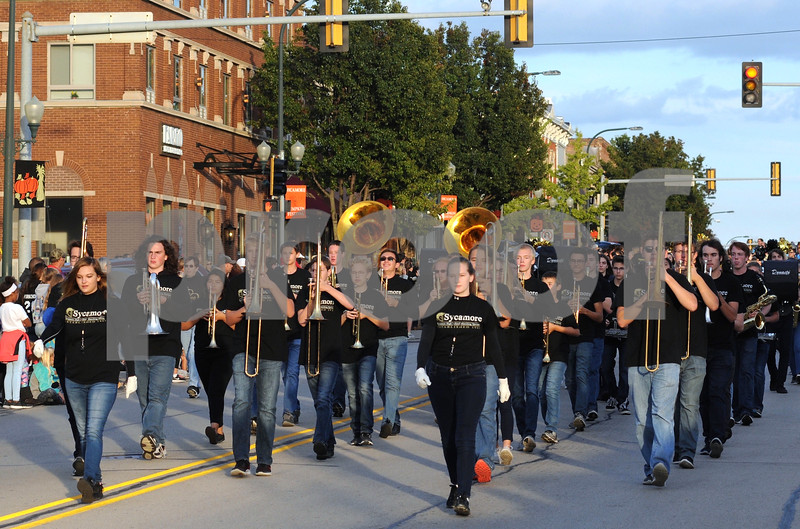 The Sycamore High School Marching Band heads down State Street during the school's homecoming parade on Wednesday.  <br /> Steve Bittinger - For Shaw Media