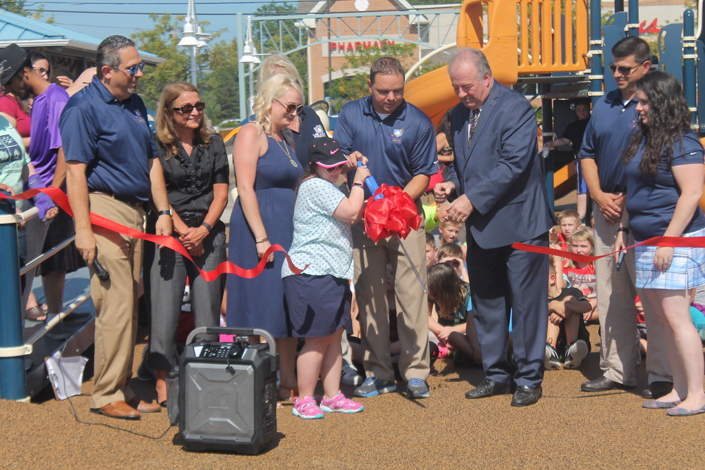. Kristi Garabrandt � The News-Herald <br> Kathy Habat, Lake County Captains manager Neil Stein and Lake County Commissioner Daniel Troy cut the ribbon for the new Lubrizol Miracle League Playground during the grand opening Sept. 21.