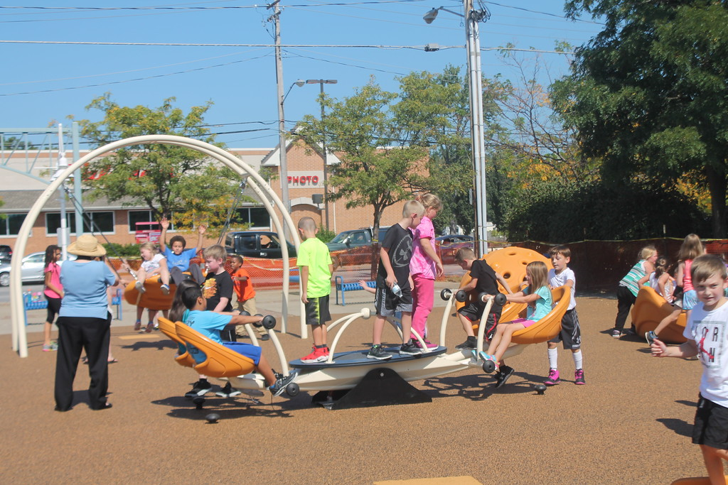 . Kristi Garabrandt � The News-Herald <br> Approximately 200 students from Longfellow Elementary School try out the new Lubrizol Miracle League Playground during the grand opening Sept. 21.
