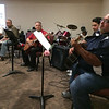 Carol Harper — The Morning Journal <br> Musicians offer lively yet mellow tunes as visitors arrive for a prayer vigil for hurricane and earthquake victims at 7 p.m. Sept. 27, 2017, at Sacred Heart Chapel at 4301 Pearl Ave. in Lorain.