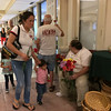 """Carol Harper — The Morning Journal <br> A man's shirt says, """"Sacred Heart S.W.A.G. Serve Worship And Glorify,"""" as visitors arrive to the sanctuary Sept. 27, 2017, for a prayer vigil for hurricane and earthquake survivors and their families at Sacred Heart Chapel at 4301 Pearl Ave. in Lorain."""