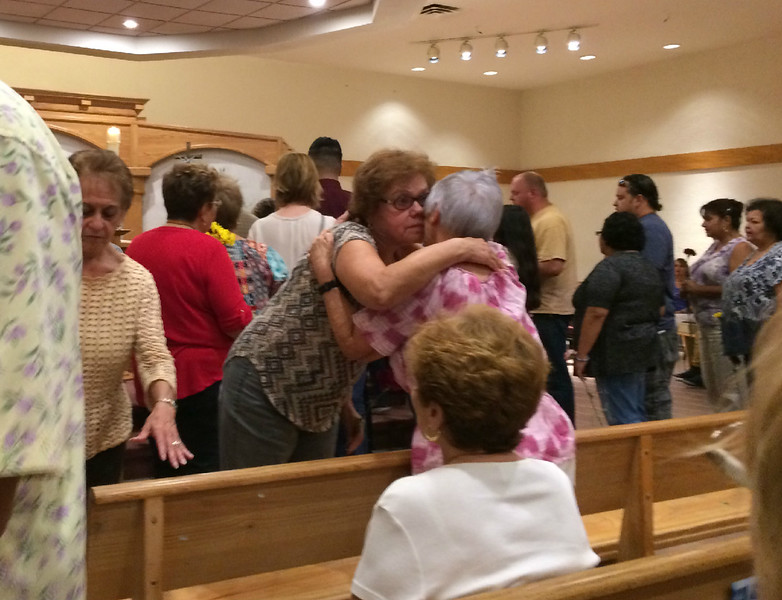 Carol Harper — The Morning Journal <br> Hugs and words of comfort abounded Sept. 27, 2017, at Sacred Heart Chapel at 4301 Pearl Ave. in Lorain. Many people in Lorain County wait for word or heard the worst regarding family members and friends after disasters in Puerto Rico and Mexico.