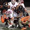 DeKalb defenders Jovon Brown (50), Donovan Lacey (32) and Jordan Gandy (8) bring down Morris running back Brandon Phelps during first quarter action in DeKalb on Friday night.<br /> Steve Bittinger - For Shaw Media