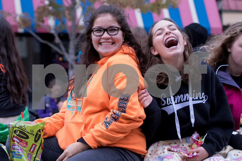 Sam Buckner for Shaw Media.<br /> DHS Swimmers Victoria Sandoval and Elizabeth White laugh and throw candy out at the homecoming parade on Thursday September 29, 2016.