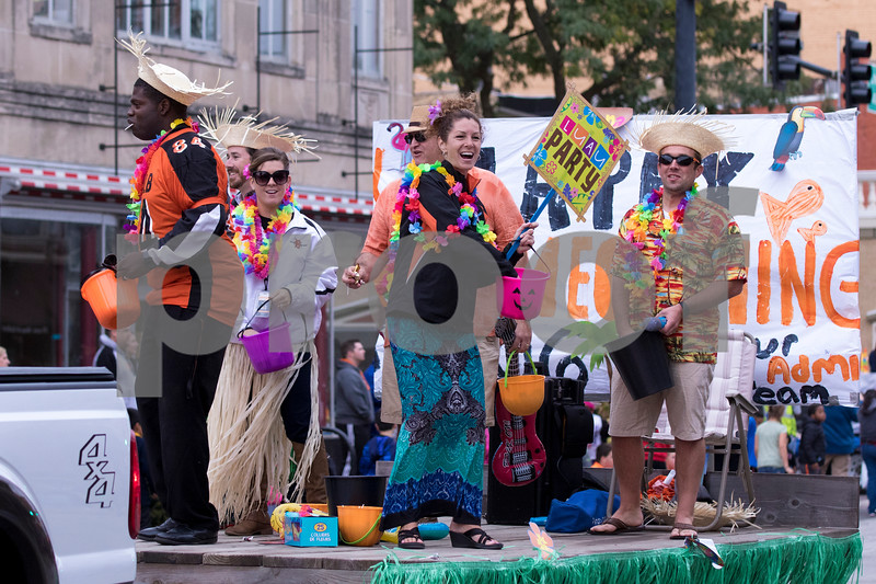 Sam Buckner for Shaw Media.<br /> DHS Administrators throw out candy on their luau float in th homecoming parade on Thursday September 29, 2016.
