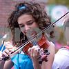 Sam Buckner for Shaw Media.<br /> Sydney Alger plays a violin on the outdoor adventure club float at the homecoming parade on Thursday September 29, 2016.
