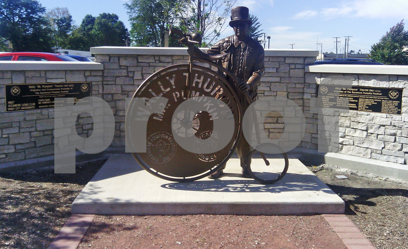 The Mr. Pumpkin statue has a few new additions on display on Thursday, September 29, 2016, in Sycamore. The Wally Thurow Tribute Committee added bronze plaques last week after the city finished installing the brick wall behind the statue. The plaques list those who donated at least $500 to the tribute fund.