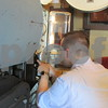 Orion Carey, chairman of the Wurlitzer Theatre Organ Committee, learns how to set a film reel into a 35mm projector that will be used to show old films at the Egyptian Theatre. Carey and Dan Woodshank, who are leading efforts to install a Wurlitzer organ into the theater, will be the only trained projectionists for the old projectors.